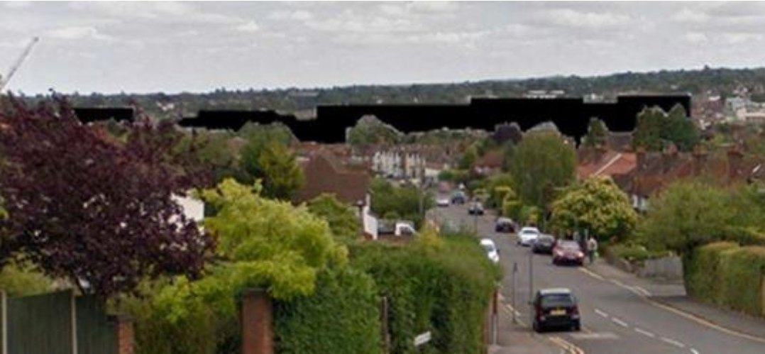 View of effect of proposed Solum development on Guildford, Surrey